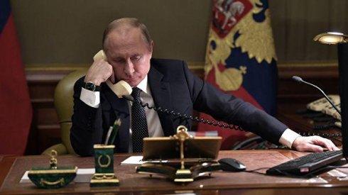 Putin Merkel və Makronla danışıb
